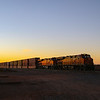 A Westbound intermodal train is waiting at the signals at East Winslow as the sun is rising over the Arizona desert, 10-10-20.