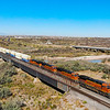 An Eastbound intermodal train is seen crossing over the Little Colorado River just outside of Winslow, Arizona on a beautiful Fall morning, 10-10-20.