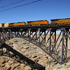 An Eastbound manifest train is seen barreling across the Arizona desert crossing the 544-foot bridge at Canyon Diablo, 10-10-10.