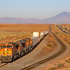 An Eastbound intermodal train is seen coming into Winslow. The 12,633 foot San Francisco Mountain is partially obscured due to residual smoke from the wildfires burning in California, 10-10-20.