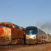 The Eastbound Southwest Chief is seen departing Winslow on a picture-perfect Arizona morning. One of the hundred or so BNSF freight trains that pass through town is seen holding waiting for The Chief to pass, 10-10-20.