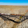 A hotshot intermodal is seen passing over the 544-foot long bridge across Canyon Diablo, East of Flagstaff, Arizona. The access road to get here is not for the faint of heart, but the reward is worth the effort. With the elevation of the DJI Mavic Air, the canyon can be seen spanning across the vast desert, 10-10-20.