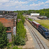 On an especially hot summer day, LA-3 is seen shoving a cut of cars past the old Boston & Maine locomotive shops at iron Horse Park in North Billerica, 6-29-21.