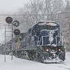Pan Am Ayer to Portland road freight AYPO is seen knocking down the distant signal at MP 294.8 in Tewksbury during another New England Winter storm, 2-7-21.