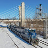 On a frigid January morning, Pan Am EDPO is seen passing the signals at CPF-GL in Fitchburg. The suspension bridge that carries Fifth Street over the tracks and the North Nashua River has a likeness to the Zakim Bridge in Boston, 1-30-21.
