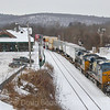 CSX Intermodal Train Q022 gets a clear signal at Palmer and throttles up to finish its run from Syracuse, NY to Worcester, MA. The train is seen passing the 19th century former Palmer Union Station, which is now the Steaming Tender Restaurant. This location is a railfan favorite, 1-21-19.