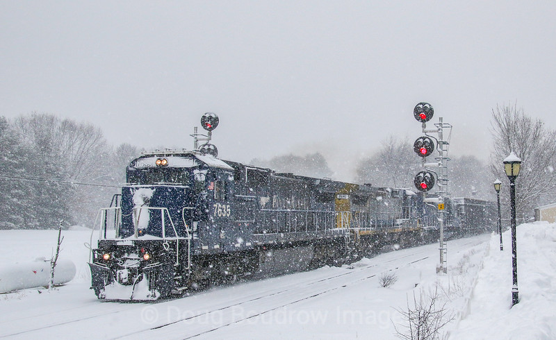Pan Am train AYPO is seen crossing over tracks after coming off Lowell Junction en route from Ayer to Portland, 2-7-21.