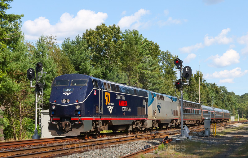 The Boston section of the Lake Shore Limited is seen passing some of the last New York Central searchlight signals on the Boston Line at CP-11 in Weston, MA. One of the 50th-anniversary units is leading the train Two of these units have been in frequent service between Boston and Chicago, 9-11-21.