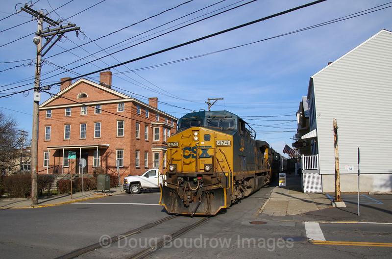 CSX Local B765 runs down the middle of South 7th Street in Hudson, 11-26-19.