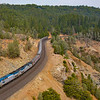 """The Westbound California Zephyr is seen at the American River Canyon in Casa Loma, CA on the way down the """"The Hill"""" from Donner Summit, 819-21."""