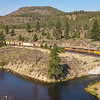 An Eastbound manifest train is seen at Boca, just east of Truckee, California. Boca is a recreation area along the Truckee River, 8-19-21.