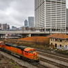 As tailgaters party before an Atlanta United soccer game, a Southbound loaded coal train with BNSF power passes the former Spring Street Tower, 3-11-18.