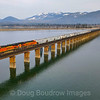 A Westbound freight train is seen crossing the 4800-foot bridge over Lake Pend Oreille from Sandpoint into Sagle, Idaho, 4-7-21.