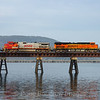 An Eastbound intermodal train is seen about to cross the 4800-foot bridge across Lake Pend Oreille, 4-7-21.