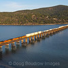 An Eastbound (track turns Northwest) intermodal train is seen crossing the 4800-foot bridge over Lake Pend Oreille in Sandpoint, Idaho in the late afternoon light, 4-6-21.