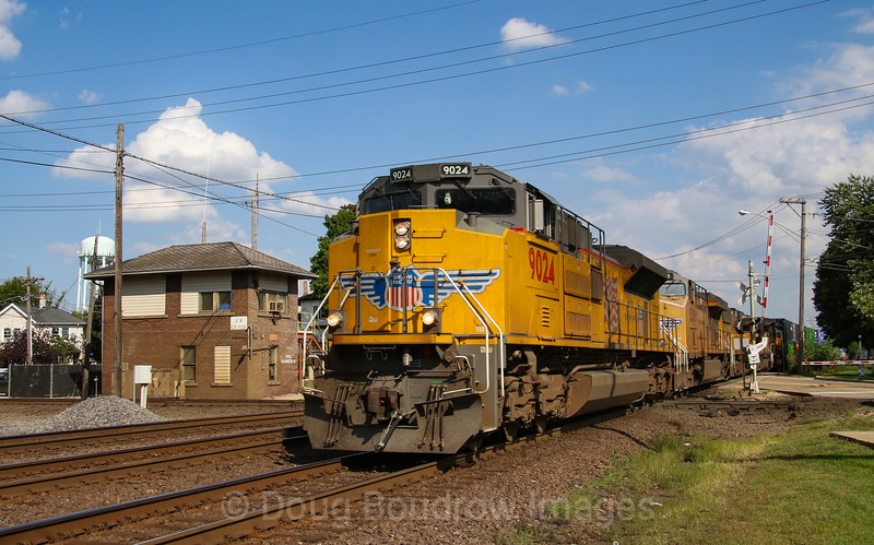 Union Pacific's line through North Chicago sees very frequent traffic and this day was no exception as an afternoon intermodal heads West across the diamond at JB Tower, 9-17-18.