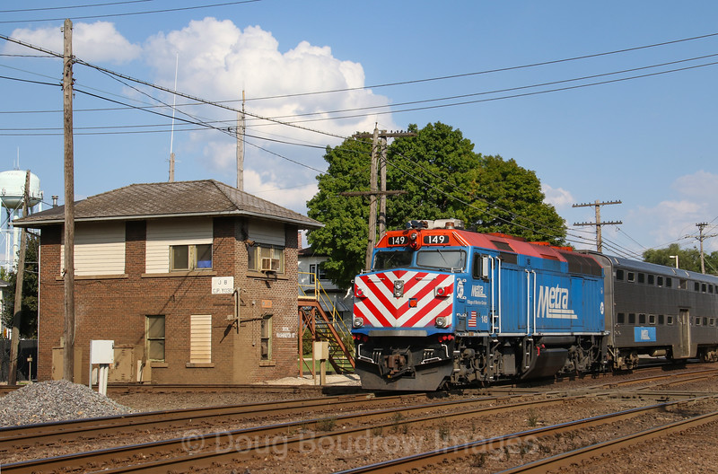 An inbound Metra train to Chicago passes JB Tower in West Chicago on the old Chicago & Northwestern route, 9-17-18.