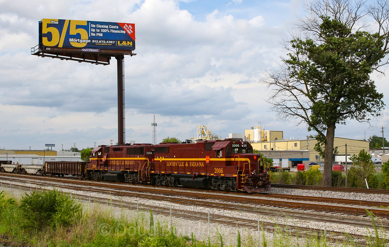 Louisville & Indiana brings a cut of cars into the yard at Jeffersonville on a humid and stormy summer afternoon, 7-16-19.