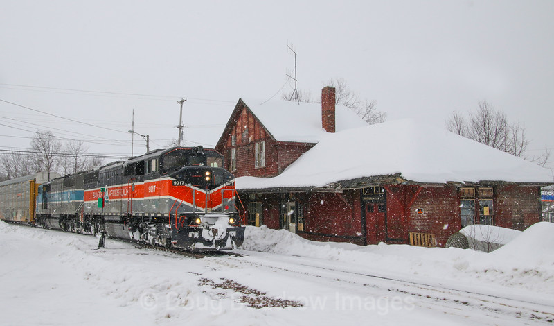 Canadian Pacific Train 250 is seen pulling through the customs scanner in Jackman, Maine after arriving from Montreal, Quebec. The Canadian crew has just handed the train over to the American crew who is taking the train through the scanner then continue to Brownville Junction, Maine. The head end is passing the abandoned and derelict 1910 Canadian Pacific Depot in the center of town. The CP purchased this line from Central Maine Quebec last year and acquired the SD40-2F locomotives in the sale. Ironically enough both the line and the locomotives used to belong to CP. The Bangor & Aroostook heritage unit is in charge today as a system power shortage has been forcing CP to put the classic engines in service, 2-20-21.
