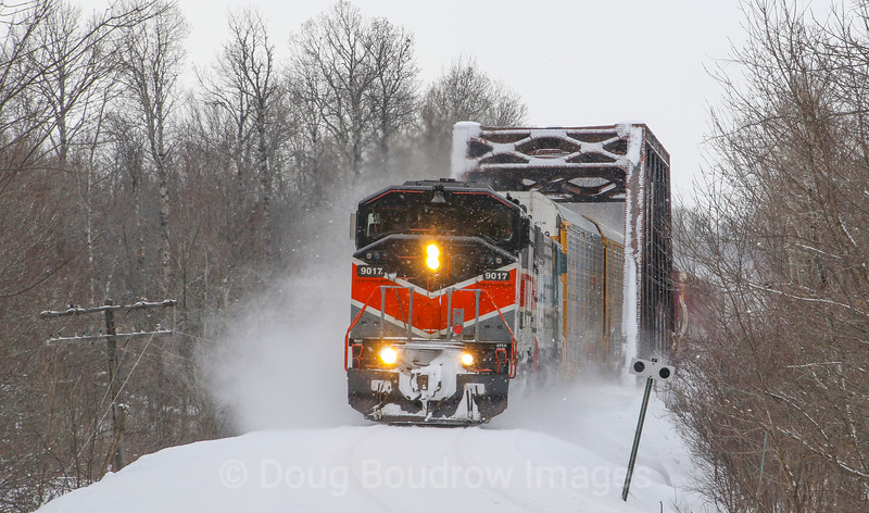 Canadian Pacific Train 250 is seen pulling into Jackman, Maine from Montreal, Quebec. The Canadian crew is still on board and will take the train to a scanner at customs. The American crew will then board and bring the train through the scanner then continue to Brownville Junction, Maine. The CP purchased this line from Central Maine Quebec last year and acquired the SD40-2F locomotives in the sale. Ironically enough both the line and the locomotives used to belong to CP. The Bangor & Aroostook heritage unit is in charge today as a system power shortage has been forcing CP to put the classic engines in service, 2-20-21.