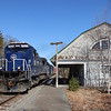 Pan Am Portland to Ayer road freight POAY is seen passing the former Boston & Maine 1906 depot at Wells Beach. The train has a matching set of all blue power with 7523, 619, 7518, 3-29-21