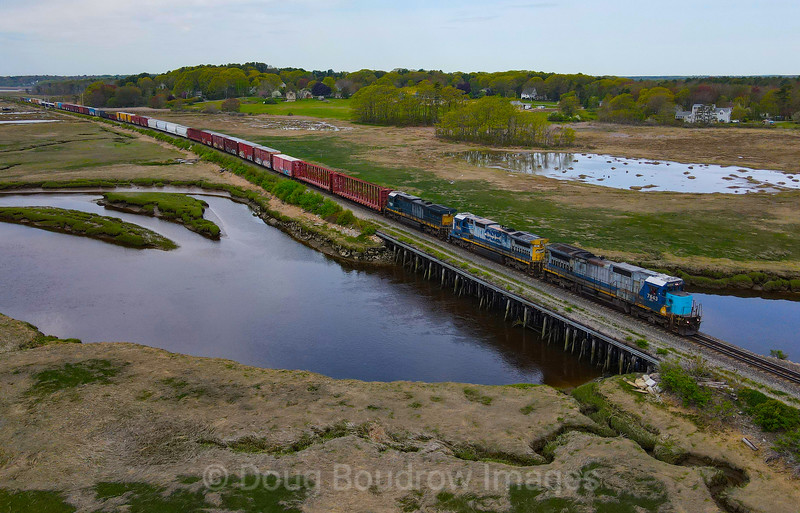 Pan Am EDPO (East Deerfield to Portland) is seen passing through the salt marsh in Scarborough with a rather horrible-looking lashup, 5-18-21.