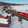 Canadian Pacific 250 is seen passing Greenville Junction and skirting along the edge of Moosehead Lake. The area is quite busy with snowmobilers and ice fishermen taking advantage of the perfect winter weather, 2-19-21.