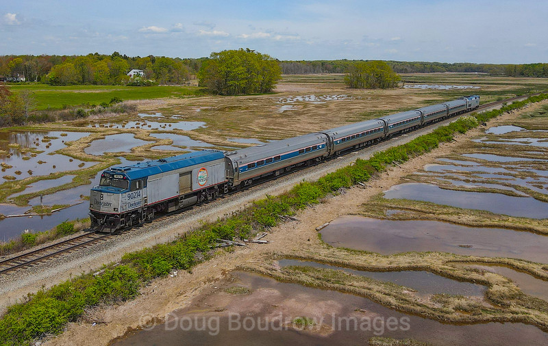 Eastbound Amtrak Downeaster 681 is seen crossing the salt marsh in Scarborough with a non-powered cab/baggage unit bringing up the markers, 5-18-21.