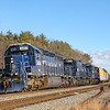 Pan Am Portland to Ayer road freight POAY is seen charging through Wells Maine past CPF-228 and the old Boston & Maine Wells Beach Depot with a matching blue consist, 12-26-20.