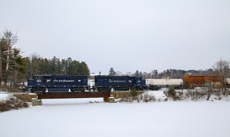 The SAAPI (South African Pulp and Paper Industries) paper mill in Hinckley, Maine is one of the largest customers on the Pan Am System. The daily train to Waterville Yard is seen returning back up the branch to the mill. The route is just a few miles, but the track speed makes for an easy chase. Note the original Maine Central boxcar still in harvest gold, 2-20-21.