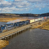 Pan Am train POAY (Portland to Ayer) is seen crossing over the Nonesuch River at Scarborough Marsh with a set of matching corporate painted power, 12-26-20.