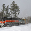 Canadian Pacific Train 250 is seen passing crossing Route 15 in Tarrantine with the sun out with simultaneous snow flurries. The CP purchased this line from Central Maine Quebec last year and acquired the SD40-2F locomotives in the sale. Ironically, both the line and the locomotives used to belong to CP. The Bangor & Aroostook heritage unit is in charge today as a system power shortage has been forcing CP to put the classic engines in service, 2-20-21.