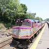 MBTA #1065 passes through Newton, MA during a hot weekday, 5-26-10.