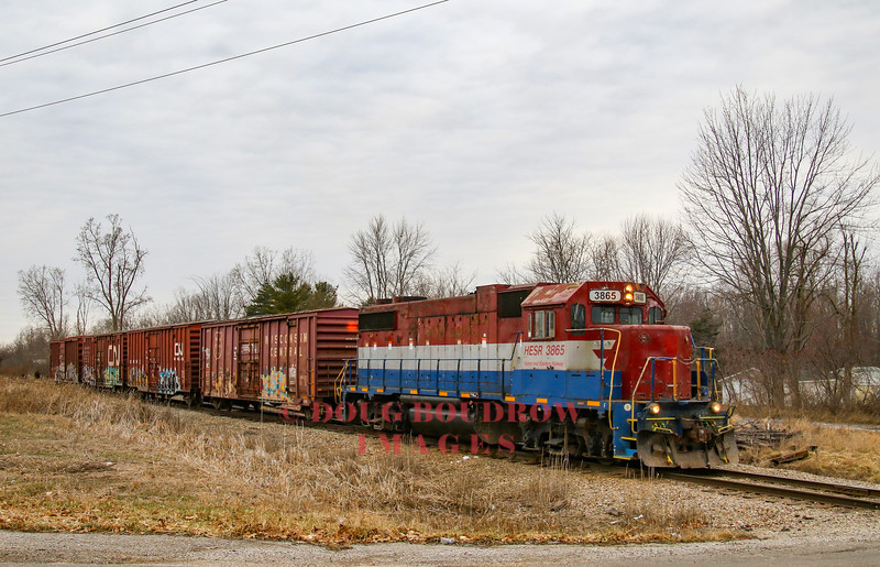 A very tired looking patched Huron & Eastern engine returns to Durand, seen leaving Owosso, 1-11-19.