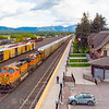 A Westbound autorack train pulls into Whitefish passing the historic depot. Here the crew change will occur and then the train will continue to the West Coast, 9-24-19.