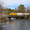 New England Southern 2555, the sole power for this shortline is seen bringing two empty slurry cars over the Winnipesaukee River in Tilton, NH. This is the second of three bridges in the Downtown Tilton area. The EMD SW1500 was originally built for the Southern Pacific in January 1970, 4-29-20.
