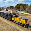 New England Southern is seen headed North through Tilton with 8 loads, an unusually long train for them. Six of the cars are spine cars loaded with ties destined to be interchanged with Plymouth & Lincoln for a tie replacement project, 4-22-20.