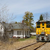 New England Southern 2555, the sole power for this shortline is seen bringing two empty slurry cars south on former Boston & Maine tracks. The train is seen passing the former Northfield depot, which is now a private residence, 4-29-20.