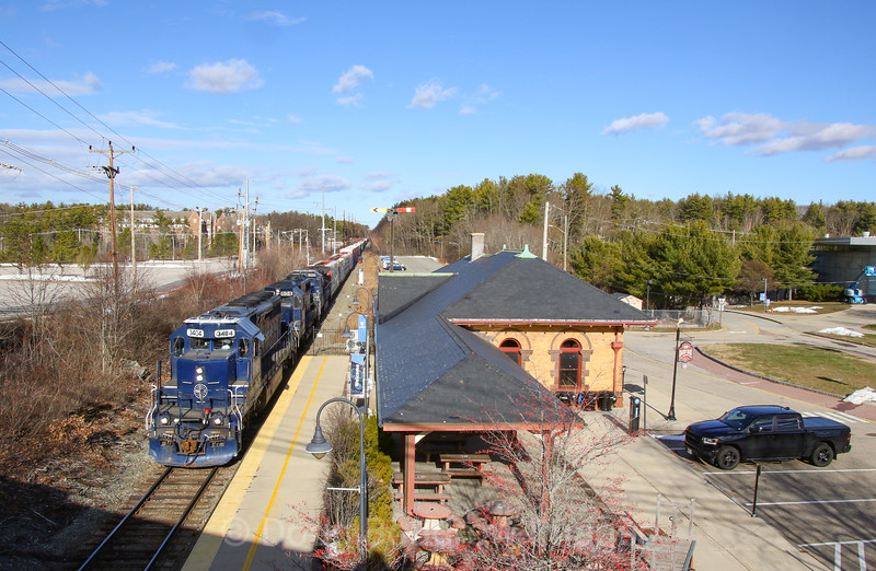 Pan Am road freight POAY is seen passing the Boston & Maine Depot in Durham, by the University of New Hampshire campus. The train has a matching set of three corporate painted units running elephant style, 12-26-20.
