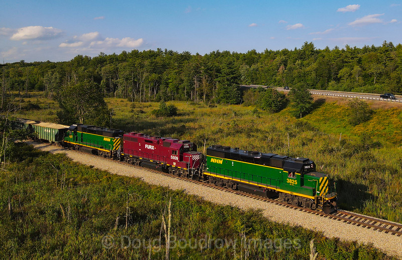 New Hampshire Northcoast D8 is seen passing Jones Forest with 32 loads of sand from the pit. Seven loads will be dropped at Tri-City in Rochester with the remaining heading to Boston Sand & Gravel, 9-8-21.