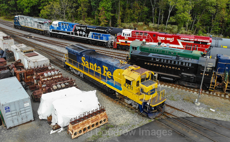 The CSX Hononoring Veterans, Honoring Law Enforcement and Honoring First Responders locomotives sit at the SMS yard in Swedesboro, NJ in preparation for an event the next day. Their former Santa Fe Dash 7 sits in the foreground, 10-4-19.