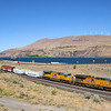 An Eastbound Union Pacific manifest freight train is seen passing through Biggs Junction along the Columbia River, 7-15-21.