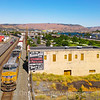 An Eastbound Union Pacific manifest freight is seen passing through The Dalles along the Columbia River Gorge, 7-15-21.