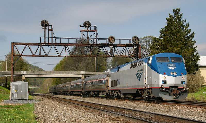 """The Eastbound """"Pennsylvanian"""" passes under the PRR signals at Summerhill. These signals will become a thing of the past once PTC is implemented, 5-12-18."""