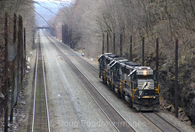 A pair of helpers head West past Cassandra, 4-4-17.