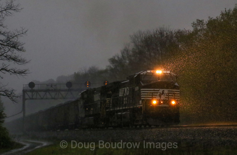 An Eastbound loaded coal train grinds up the West Slope through Lilly during a driving thunderstorm, 5-12-18.