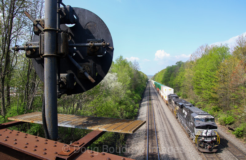 An Eastbound hotshot intermodal passes under Johnstown Road with the PRR signals still in operation in the foreground. With the implementation of PTC, the days of these pieces of history are numbered, 5-12-18.