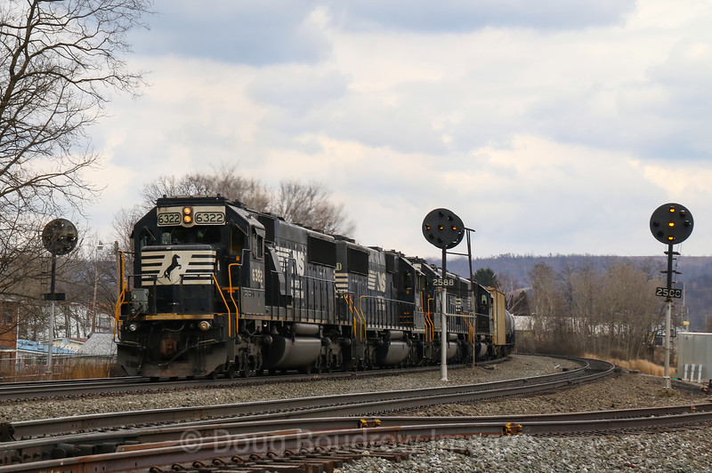 A four-pack of helpers shove loaded tank train 64R up the West Slope at Portage, 4-6-19.