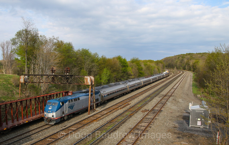 "The Westbound ""Pennsylvanian"" passes under the old Pennsy signal bridges at Cresson with two private cars on the rear,  5-11-18."