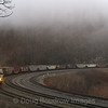 A pair of Norfolk Southern wide cabs sling an empty coal drag up around the world-famous Horseshoe Curve, just West of Altoona, PA on a very foggy Saturday morning., 4-6-19.